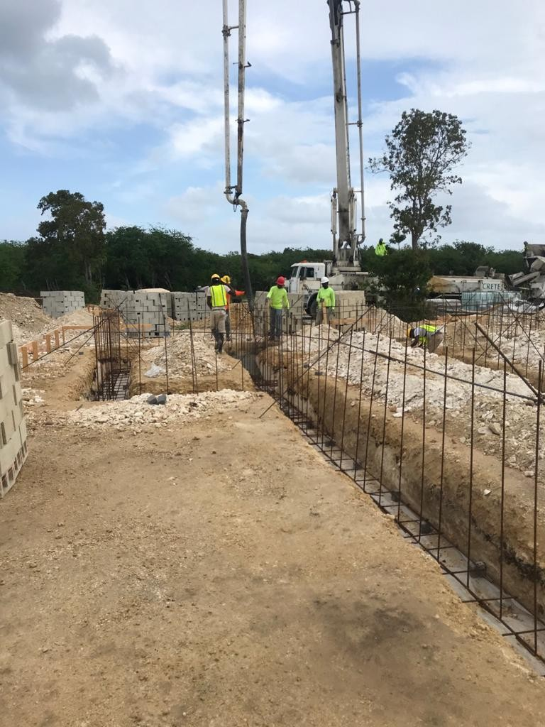 Site update: Pouring of the concrete for the building footing 2 of 3